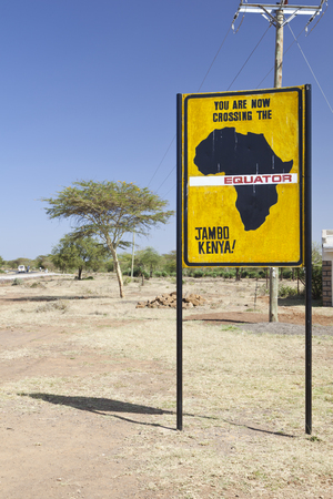 equator: Famous signs when crossing the equator in Kenya.