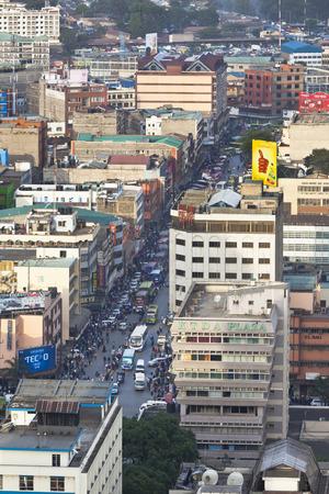 highrises: Nairobi, Kenya - February 7: Lots of people and Matatus in the business district of Nairobi, Kenya on February 7, 2013