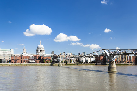 millennium bridge: Millennium Bridge in London with St. Pauls Cathedral in the background and a beautiful sky