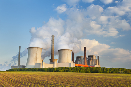 A coal-fired power station on a hill in the evening Stock Photo