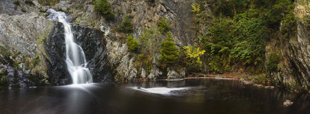 the ardennes: Panoramic view of a waterfall in a canyon in the High Fens, Ardennes, Belgium. Long exposure shot.