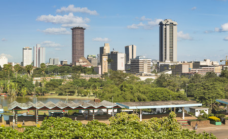 Skyline of Nairobi, Kenya with Uhuru Park in the foreground and a helicopter on top of the KICC.