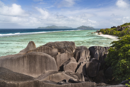 pristine coral reef: High angle view of the famous Anse Source DArgent in La Digue, Seychelles from an observation point with granite rocks in the foreground Stock Photo