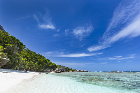 d'argent: Tropical white beach Anse Pierrot near Source DArgent in La Digue, Seychelles with deep blue sky