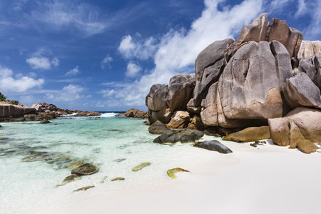 cocos: Tall granite rock formation and emerald water at Anse Cocos in La Digue, Seychelles Stock Photo