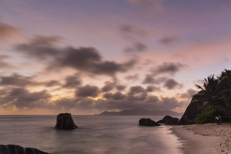 d'argent: Colorful sunset long exposure at Anse Source DArgent in La Digue, Seychelles with granite rocks in the foreground