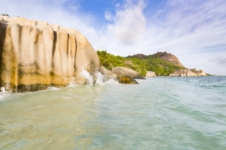 d'argent: Waves splashing against granite rocks at Anse Source DArgent in La Digue, Seychelles