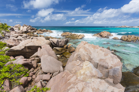 cocos: Granite rocks and turquoise water at Anse Cocos in La Digue, Seychelles Stock Photo