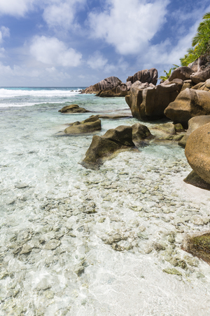 pristine corals: Shallow water and corals at Anse Cocos in La Digue, Seychelles Stock Photo