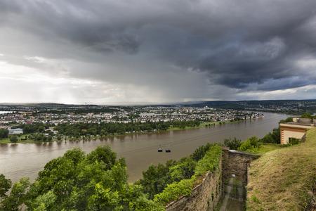 rheintal: View along the Rhine valley in Koblenz, Germany with dark rain clouds seen from Ehrenbreitstein. Stock Photo
