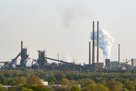 coking: View of a large coking and steel plant in Duisburg, Germany with a steaming quench tower.