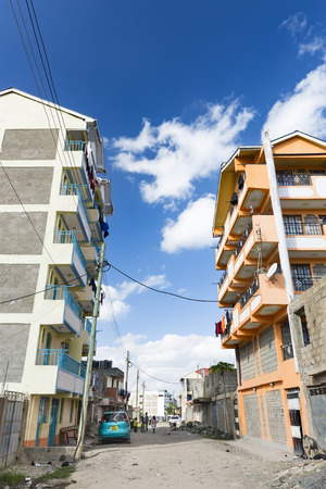 december 21: NAIROBI - DECEMBER 21: Typical village street in the mid level residential districts of east Nairobi, Kenya on December 21, 2015 Editorial