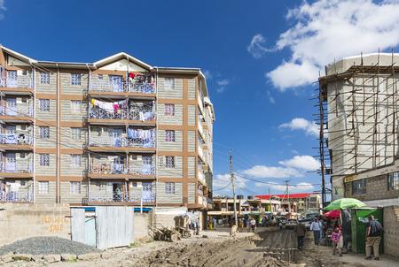 december 21: NAIROBI - DECEMBER 21: Tassia village center with muddy streets in the of east Nairobi, Kenya on December 21, 2015