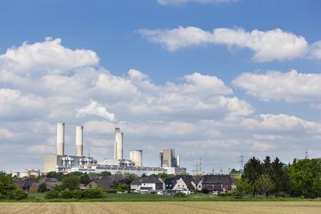 lignite: A decommissioned lignite power station behind a village