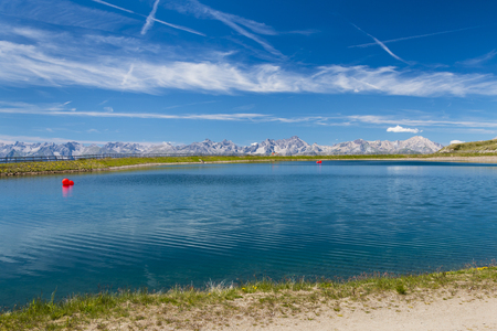 alpen: A reservoir lake with red balloons in the Pitztal, Austria