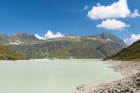 The Silvretta Stausee Reservoir Lake in Summer, Austria with deep blue sky Stock Photo