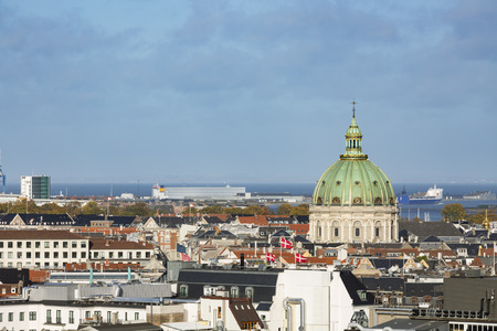 View over central Copenhagen, Denmark with the dome of Frederiks Church in the center.