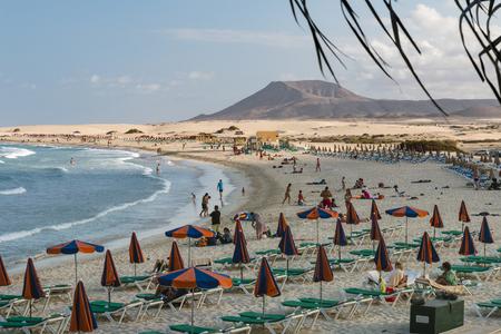 FUERTEVENTURA - SEPTEMBER 19: Tourists enjoying the summer at Corralejo Beach in Fuerteventura, Spain on September 19, 2015