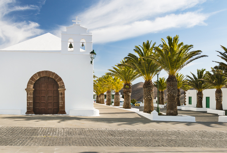 White church and palm trees in Femes in Lanzarote, Spain. Stock fotó