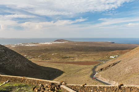View from the Mirador de Femes in Lanzarote, Spain to Playa Blanca and Montana Roja, with Fuerteventura in the background.