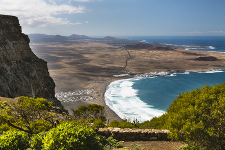 View from the Mirador del Boscquecillo in Lanzarote, Spain over Famara Bay. Stok Fotoğraf