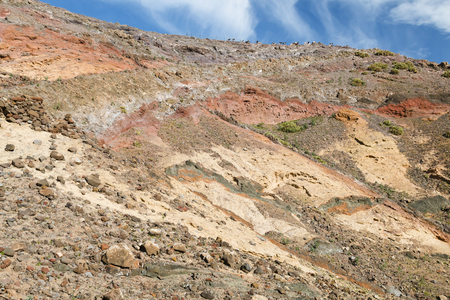View of colorful volcanic soil layers in Lanzarote, Spain near the village of Femes.