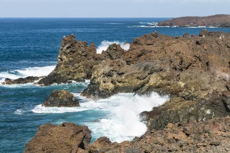 Los Hervideros rocks with splashing waves near El Golfo in Lanzarote, Spain.