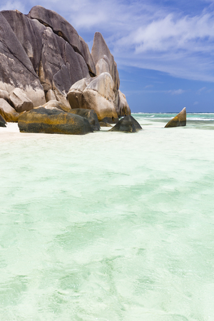 Turquoise water and granite rocks at Anse Source DArgent in La Digue, Seychelles Stock Photo