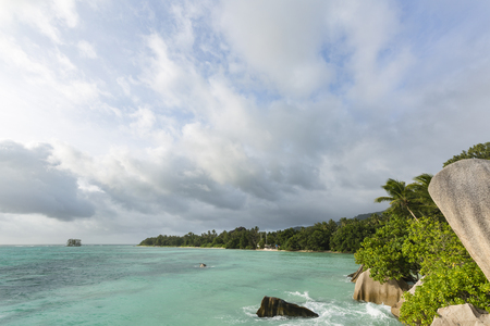 Beautiful bay Anse Source DArgent in La Digue, Seychelles with scenic granite rocks in evening light