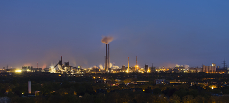coking: Panoramic view of a large coking and steel plant in Duisburg, Germany in the night with tapping resulting in the red glow.