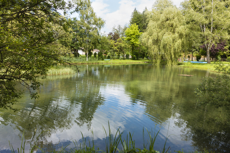 alpen: View over a park lake in Grainau, Germany in summer.