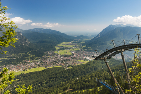 View from Kreuzeck to Garmisch-Partenkirchen, Germany with the flatter Bavarian landscape in the background.