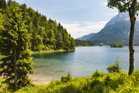 View over lake Eibsee with some islands near the Wetterstein in Garmisch-Partenkirchen, Germany in summer.