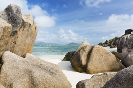Perfect white beach Anse Source DArgent in La Digue, Seychelles with large granite rocks in the morning