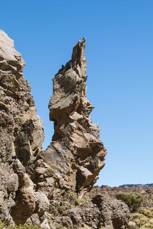 Rock needle formation at Los Roques de Garcia In Tenerife, Spain with blue sky.