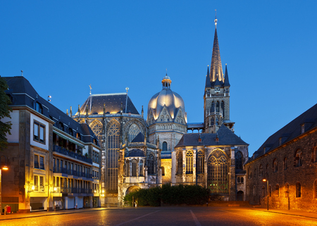 The cathedral of Aachen, Germany with night blue sky.