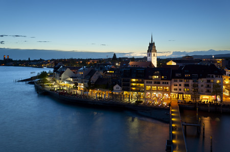 View of Friedrichshafen and Lake Constance from the observation tower at night, Germany. Stock Photo