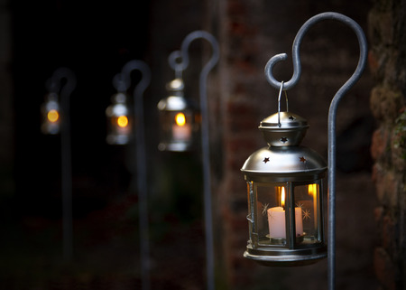 a row of outdoor christmas lanterns with selective focus and dark background stock photo