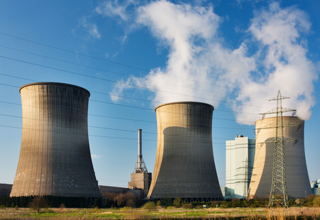 three generations: Three tall cooling towers of a coal-fired power station.