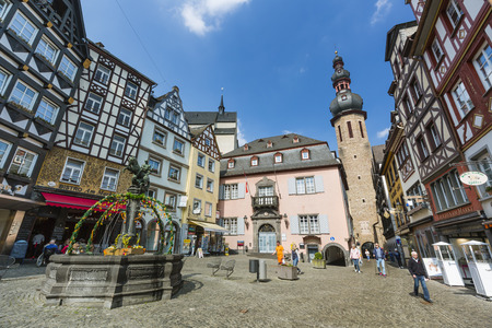 COCHEM - APRIL 03: Town hall and market square in Cochem, Germany with a few tourists on April 03, 2017.