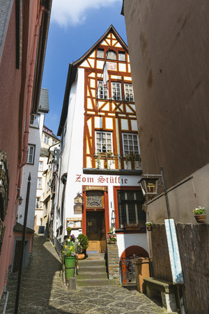 COCHEM - APRIL 03: Old restaurant Zom Stueffje in an half-timbered houses in the Oberbachstrasse in Cochem, Germany on April 03, 2017. Publikacyjne