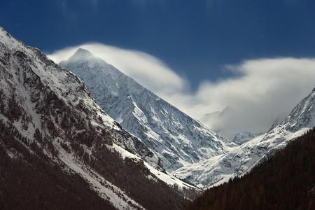alpen: The moonlight shining on the Schrankogel (3496m) in Austria. Stock Photo