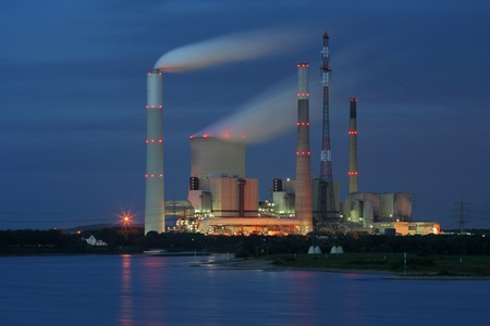 Coal-Fired power plant near Voerde, Germany. In front the  rhine river. Stock Photo