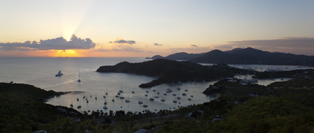 Sunset over English Harbour in Antigua. The island on the horizon is Montserrat.