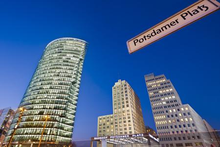 Night shot at Potsdamer Platz in Berlin with a street sign.