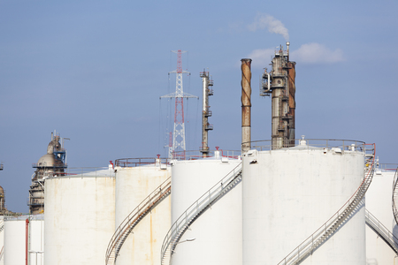 Some storage tanks in a large refinery.