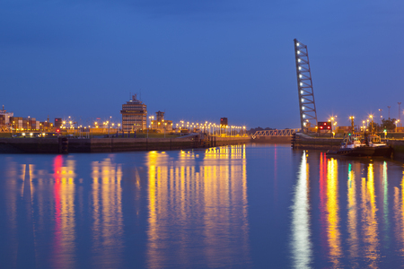 An open canal lock in the harbour of Antwerp. Stock Photo