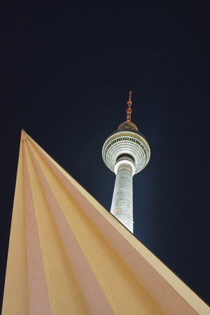 The famous 368m tall Berlin TV Tower at Alexanderplatz at night. Stock Photo