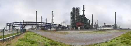 A large oil refinery in the harbor of Antwerp on a gray day. Panoramic version. Stok Fotoğraf