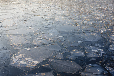 Ice floes in a frozen river surface. Stock Photo